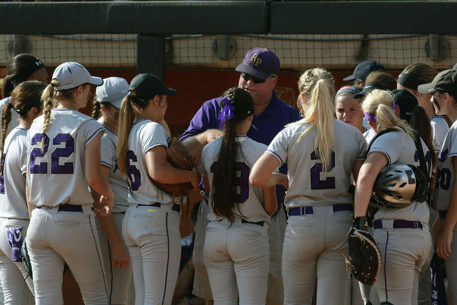 Ridge Point head coach James McClanahan, center, tries to pump up his team between innings during their Class 5A UIL State Softball Championship semi-final matchup versus Aledo at McCombs Field in Austin on Friday, June 5, 2015. (Photo by Jerry Baker/Freelance) Photo: Jerry Baker, For The Chronicle