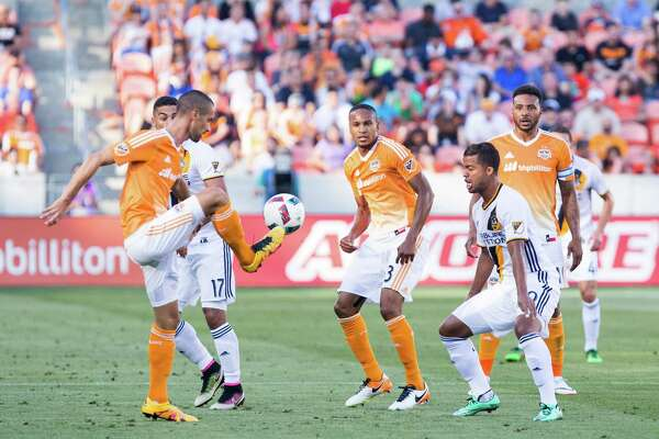Houston Dynamo defender Raul Rodriguez (5) dribbling in front of Los Angeles Galaxy forward Giovani dos Santos (10) during the first half of action against LA Galaxy during a soccer game at the BBVA Stadium, Friday, Apr. 15, 2016, in Houston. Los Angeles Galaxy defeated Houston Dynamo 4-1.  ( Juan DeLeon / For the Houston Chronicle )