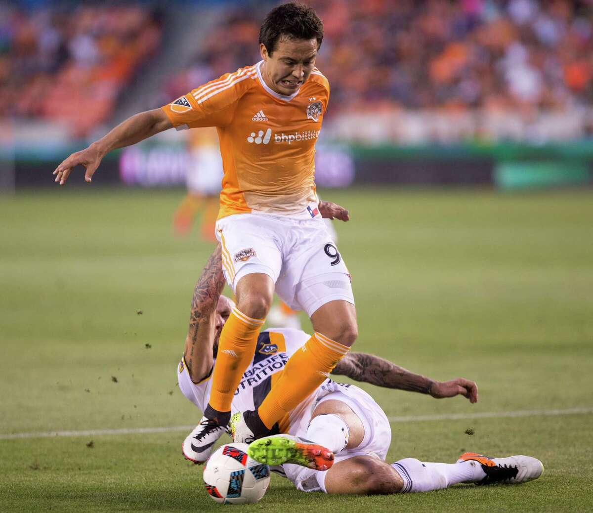 Houston Dynamo forward Erick Torres (9) is slide tackle by Los Angeles Galaxy defender Jelle Van Damme (37) on the field during the second half of action during a soccer game at the BBVA Stadium, Friday, Apr. 15, 2016, in Houston. Los Angeles Galaxy defeated Houston Dynamo 4-1. ( Juan DeLeon / For the Houston Chronicle )