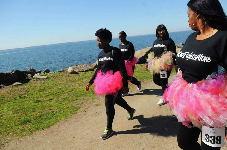 Michelle Jones, left, a breast cancer survivor, walks with friends from left, Patricia Johnson, Quantishay Hall and Stephanie Hall during the CancerCare's fourth annual 2016 Walk/Run for Hope at Greenwich Point in Greenwich, Conn., April 18, 2016. Jones credits her friends with providing support that was critical to her successful battle with the disease. More than 300 people came out to support CancerCare, which is a free, professional support service available to anyone with a cancer diagnosis. Photo: Keelin Daly, For Hearst Connecticut Media / Greenwich Time freelance