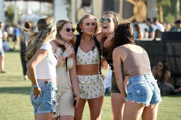 INDIO, CA - APRIL 15:  Music fans attend day 1 of the 2016 Coachella Valley Music & Arts Festival at the Empire Polo Club on April 15, 2016 in Indio, California.  (Photo by Frazer Harrison/Getty Images for Coachella)
