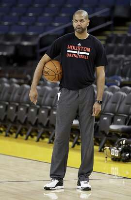 Houston Rockets coach J.B. Bickerstaff watches the team practice Friday, April 15, 2016, in Oakland, Calif. The Rockets play the Golden State Warriors in Game 1 of a first-round NBA basketball playoff series Saturday. (AP Photo/Ben Margot)