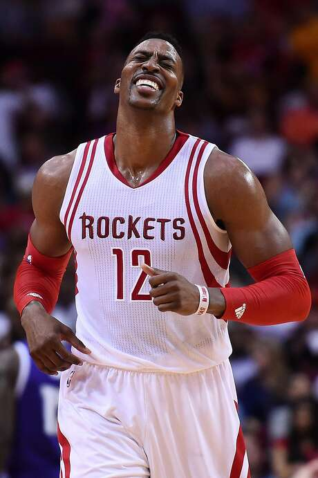 HOUSTON, TEXAS - APRIL 13:  Dwight Howard #12 of the Houston Rockets reacts to a missed three point shot as time expired in the first half of a game against the Sacramento Kings at the Toyota Center on April 13, 2016 in Houston, Texas. The Rockets defeated the Kings 116-81.  NOTE TO USER: User expressly acknowledges and agrees that, by downloading and or using this photograph, User is consenting to the terms and conditions of the Getty Images License Agreement.  (Photo by Stacy Revere/Getty Images) Photo: Stacy Revere, Getty Images