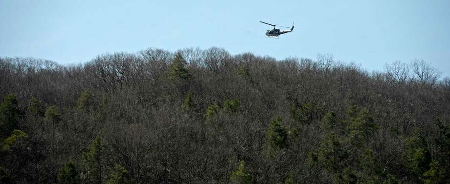 Eagle 1 search and rescue helicopter flies over Clatter Valley Park, in New Milford, during a search and rescue drill  on Saturday, April 16, 2016, in New Milford, Conn. Photo: H John Voorhees III / Hearst Connecticut Media / The News-Times