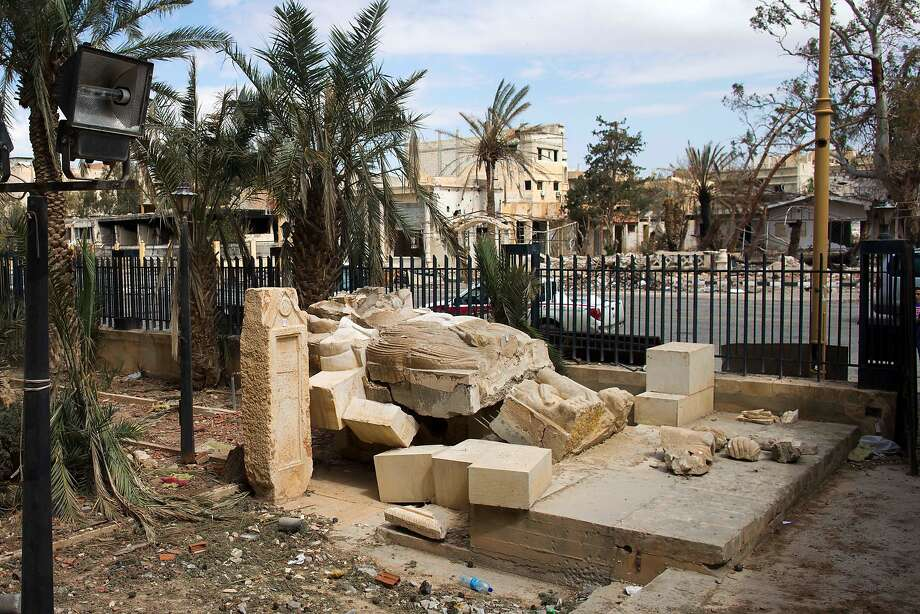 A destroyed statue lies outside the Palmyra museum where some captives were beheaded in the courtyard. Photo: Hassan Ammar, Associated Press