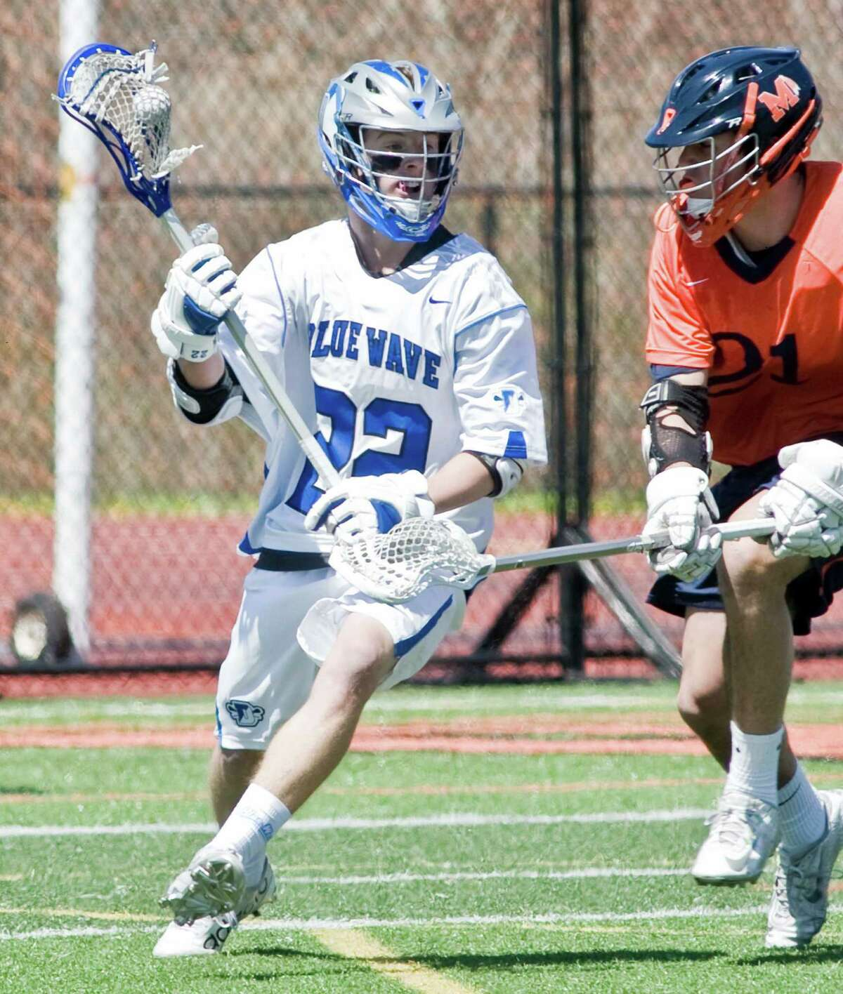 Darien High School's Hudson Hamill tries to get by Manhasset High School's Peter Colan in a game played at Ridgefield High School. Saturday, April 16, 2016
