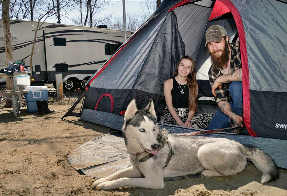 Campers relax with a furry pal at the newly opened campground at Schodack Island State Park.