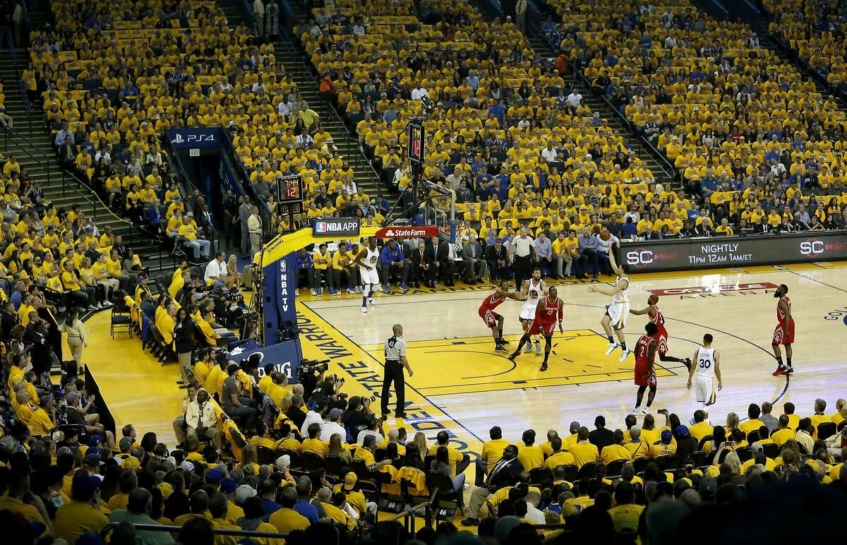 Warriors' Klay Thompson puts up a shot in the first quarter, as the Golden State Warriors take on the Houston Rockets in game 1 of the first round of the NBA Playoffs at the Oracle Arena in Oakland, California on Sat. April 16, 2016.