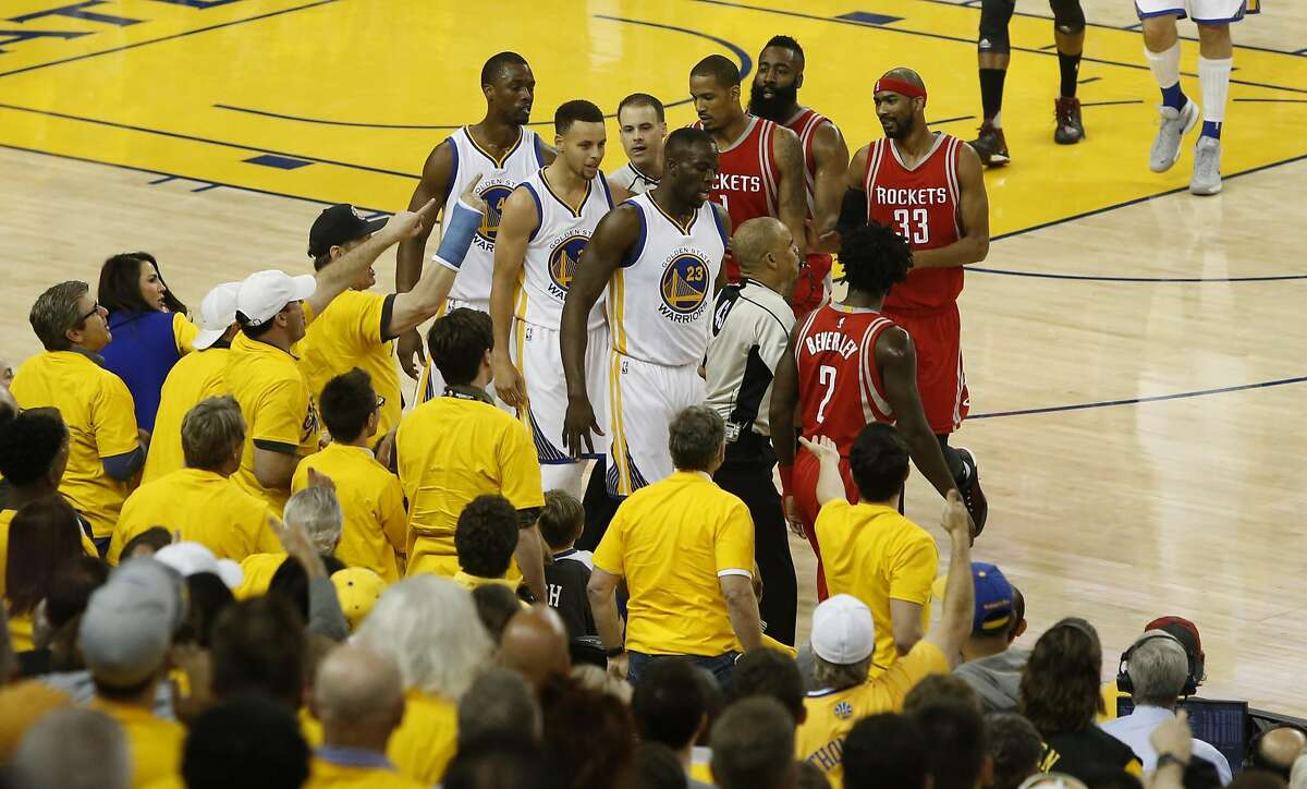 Tempers heat up early in the first quarter as Warriors' Stephen Curry and Patrick Beverley had to be pulled apart as the Golden State Warriors take on the Houston Rockets in game 1 of the first round of the NBA Playoffs at the Oracle Arena in Oakland, California on Sat. April 16, 2016.