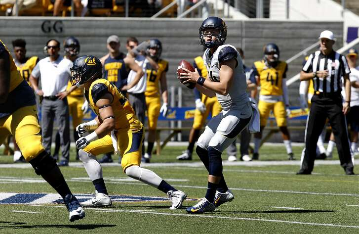 Quarterback Chase Forrest, center, prepares to throw a pass during UC Berkeley's Cal Football Spring Scrimmage in Berkeley, Calif., on Saturday April 16, 2016