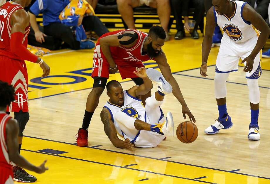 Warriors' Andre Iguodala and the Rockets' James Harden get tangled up in the second quarter, as the Golden State Warriors  take on the Houston Rockets in game 1 of the first round of the NBA Playoffs at the Oracle Arena in Oakland, California on Sat. April 16, 2016. Photo: Michael Macor, The Chronicle
