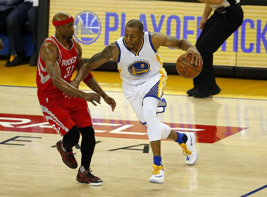 Rockets' Jason Terry covers the Warriors' Andre Iguodala in the second quarter, as the Golden State Warriors  take on the Houston Rockets in game 1 of the first round of the NBA Playoffs at the Oracle Arena in Oakland, California on Sat. April 16, 2016. Photo: Michael Macor, The Chronicle