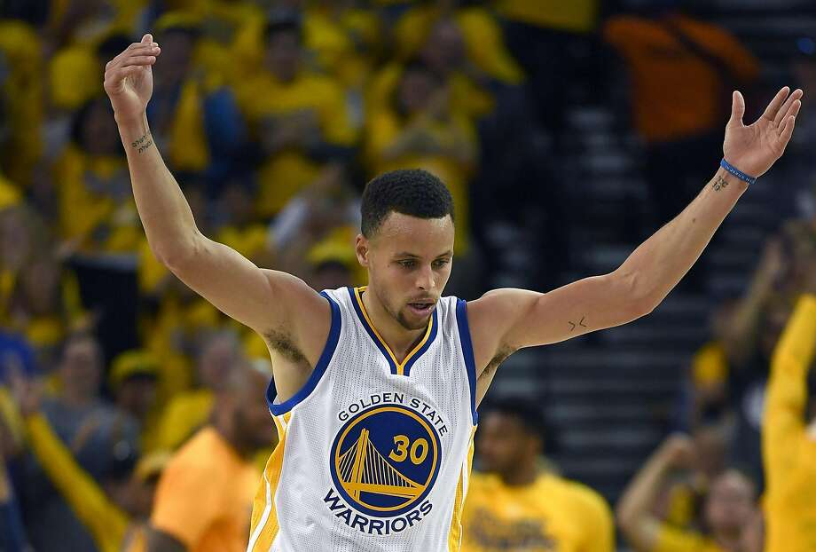 Stephen Curry reacts after hitting a three-point shot against the Houston Rockets in the second quarter in Game One of the Western Conference Quarterfinals during the 2016 NBA Playoffs at ORACLE Arena. Photo: Thearon W. Henderson, Getty Images