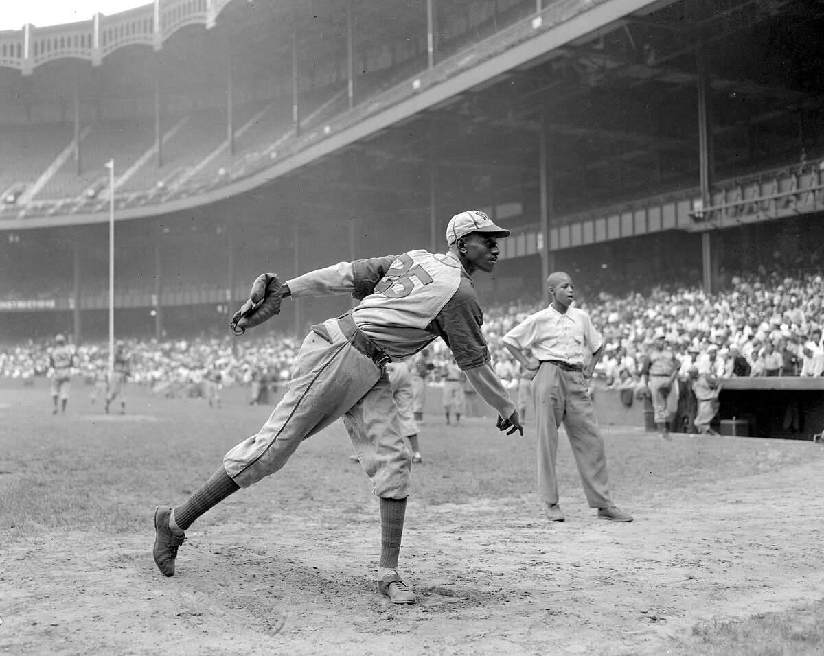 Kansas City Monarchs pitching great Leroy Satchel Paige pratices at New York's Yankee Stadium August 2, 1942 for a Negro League game between the Monarchs and the NewYork Cuban Stars. Paige was considered a top prospect for the major leagues after baseball's commisioner ruled that there were no provisions barring players of color from the majors. (AP Photo/Matty Zimmerman)