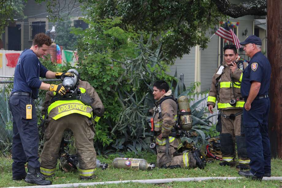 San Antonio Firefighters battled a house fire in Northwest Central San Antonio, Saturday April 16, 2016, that sent one person to the hospital. Photo: Tyler White