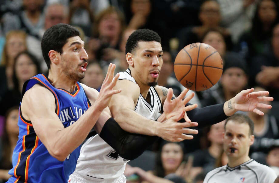 SAN ANTONIO,TX - APRIL 12: Danny Green #14 of the San Antonio Spurs battles Enes Kanter #11 of the Oklahoma City Thunder for a loose ball at AT&T Center on April 12, 2016 in San Antonio, Texas.  NOTE TO USER: User expressly acknowledges and agrees that , by downloading and or using this photograph, User is consenting to the terms and conditions of the Getty Images License Agreement. (Photo by Ronald Cortes/Getty Images) Photo: Ronald Cortes, Stringer / Getty Images / 2016 Getty Images