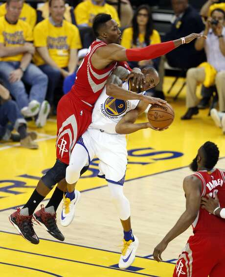 Houston Rockets' Dwight Howard commits a hard foul on Golden State Warriors' Andre Iguodala in 4th quarter of warriors' 104-78 win in Game 1 of 1st round of NBA Playoffs at Oracle Arena in Oakland, Calif., on Saturday, April 16, 2016. Photo: Scott Strazzante, The Chronicle