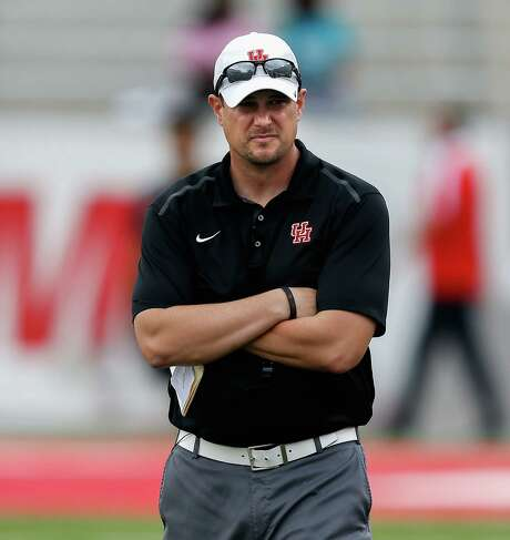 Houston Cougars head coach Tom Herman looks on during the Houston Cougars Red and White game, Saturday, April 16, 2016, in Houston. Photo: Bob Levey, Houston Chronicle / ©2016 Bob Levey