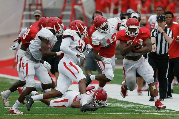 Houston Cougars running back Josh Burrell (28) rushes with the ball during the Houston Cougars Red and White game, Saturday, April 16, 2016, in Houston.