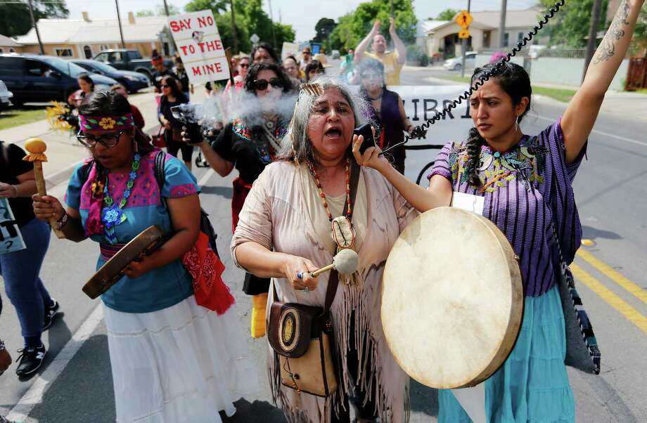 Yvette Mendez (center) with Edyka Chilome (right) and Marlene Villanueva of Alma de Mujer participate in a protest march against a coal mine operation in Eagle Pass, Texas on Saturday, Apr. 16, 2016. Native American tribes have joined environmentalists in a fight against a Dos Republicas coal mine in Eagle Pass with a nine-mile protest march to the coal mine on the outskirts of town. Despite delays by the opposition, the mine started operating last year producing high-sulfur coal and shipping the coal to a parent-company plant in Mexico to burn. Nearly 150 protestors started in Shelby Park near the U.S.-Mexico border in Eagle Pass and made an hours-long trek to the plant to once again voice their opposition. They cite the plants lack of environmental concerns, the lack of economic development and the lack of oversite by the Native American groups as several of the issues they protestors have with the coal mine operators.  (Kin Man Hui/San Antonio Express-News) Photo: Kin Man Hui, Staff / San Antonio Express-News / ©2016 San Antonio Express-News