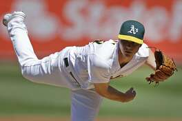 Oakland Athletics pitcher Sonny Gray works against the Kansas City Royals in the first inning of a baseball game Saturday, April 16, 2016, in Oakland, Calif. (AP Photo/Ben Margot)