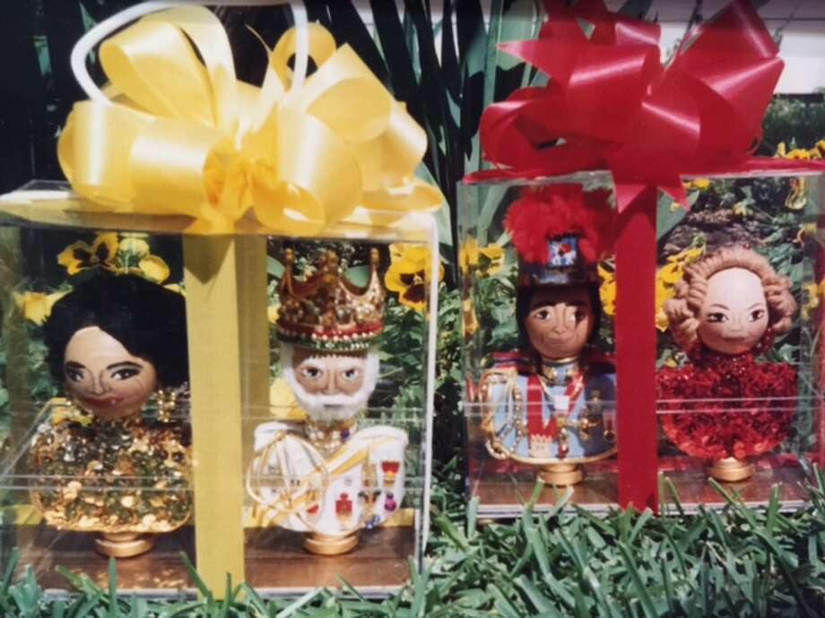 Hand-painted Kings' Eggs from Fiesta San Antonio 1993 represent Rey Feo XLIV Peter Reed (egg with white beard) and his wife Sister Schodts Reed (in box on left, yellow ribbon); and King Antonio LXXI John H. White Jr. and his wife Laurie M. White. Known as 'Little Kings and Royal Consorts,' eggs crafted as likenesses of the Fiesta kings and their wives are presented each year at NIOSA. Photo: Courtesy /San Antonio Conservation Society