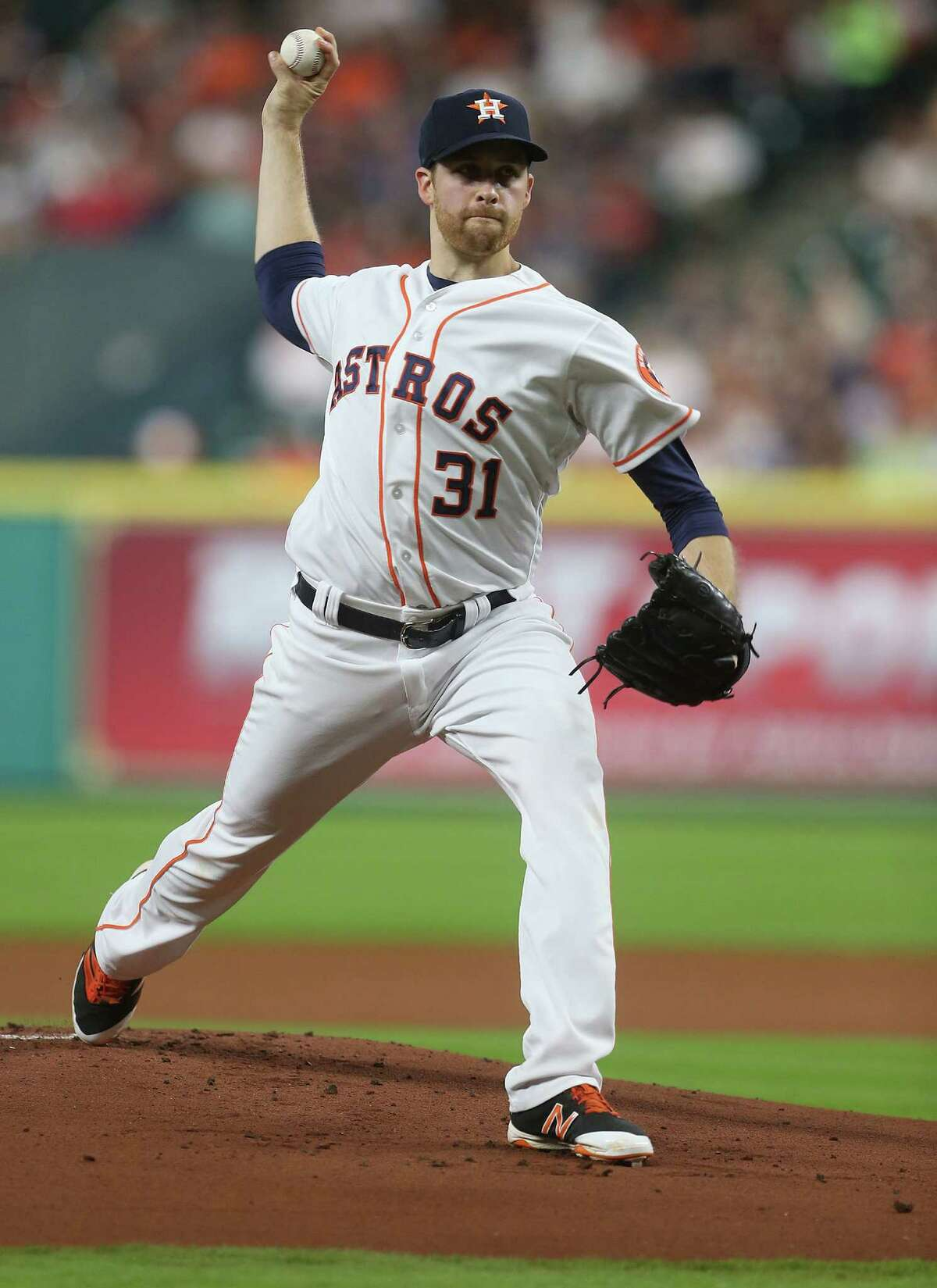 Houston Astros starting pitcher Collin McHugh (31) pitches in the first inning against the Detroit Tigers second baseman Ian Kinsler (3). Photos of second game in a three-game series between Houston Astros and Detroit Tigers on Saturday, April 16, 2016, in Houston. Astros lead the series 1-0.