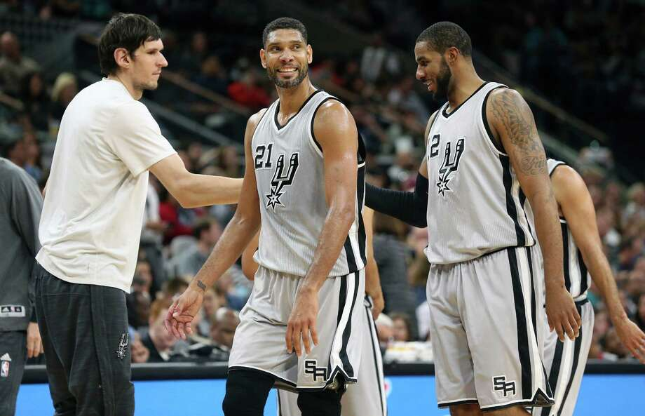 Spurs big men tim Duncan and LaMarcus Aldridge come off the court to get congratulations from Boban Majonovic as the Spurs host the Grizzlies at the AT&T Center on March 25, 2016. Photo: TOM REEL, STAFF / SAN ANTONIO EXPRESS-NEWS / 2016 SAN ANTONIO EXPRESS-NEWS