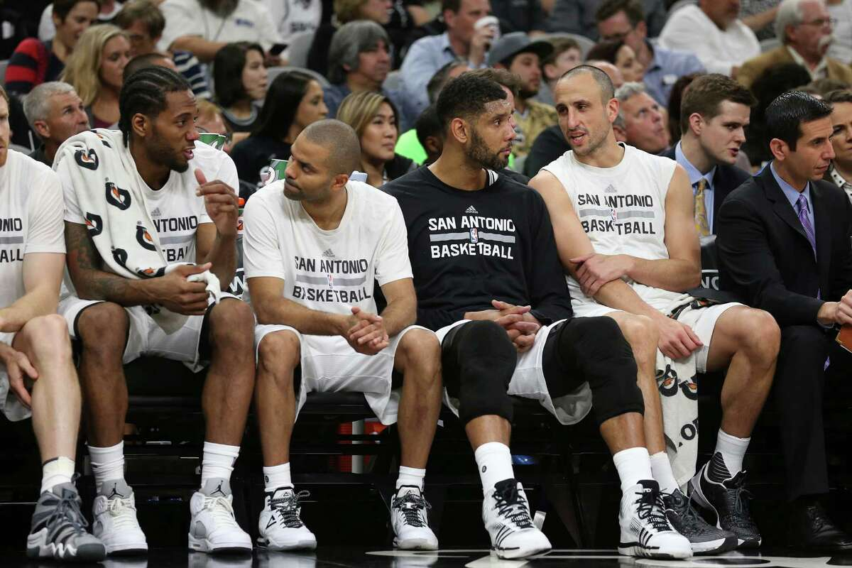 From left, San Antonio Spurs' Kawhi Leonard, Tony Parker, Tim Duncan and Manu Ginobili sit on the bench during the second half against the New Orleans Pelicans at the AT&T Center, Wednesday, March 30, 2016. The Spurs won, 100-92.