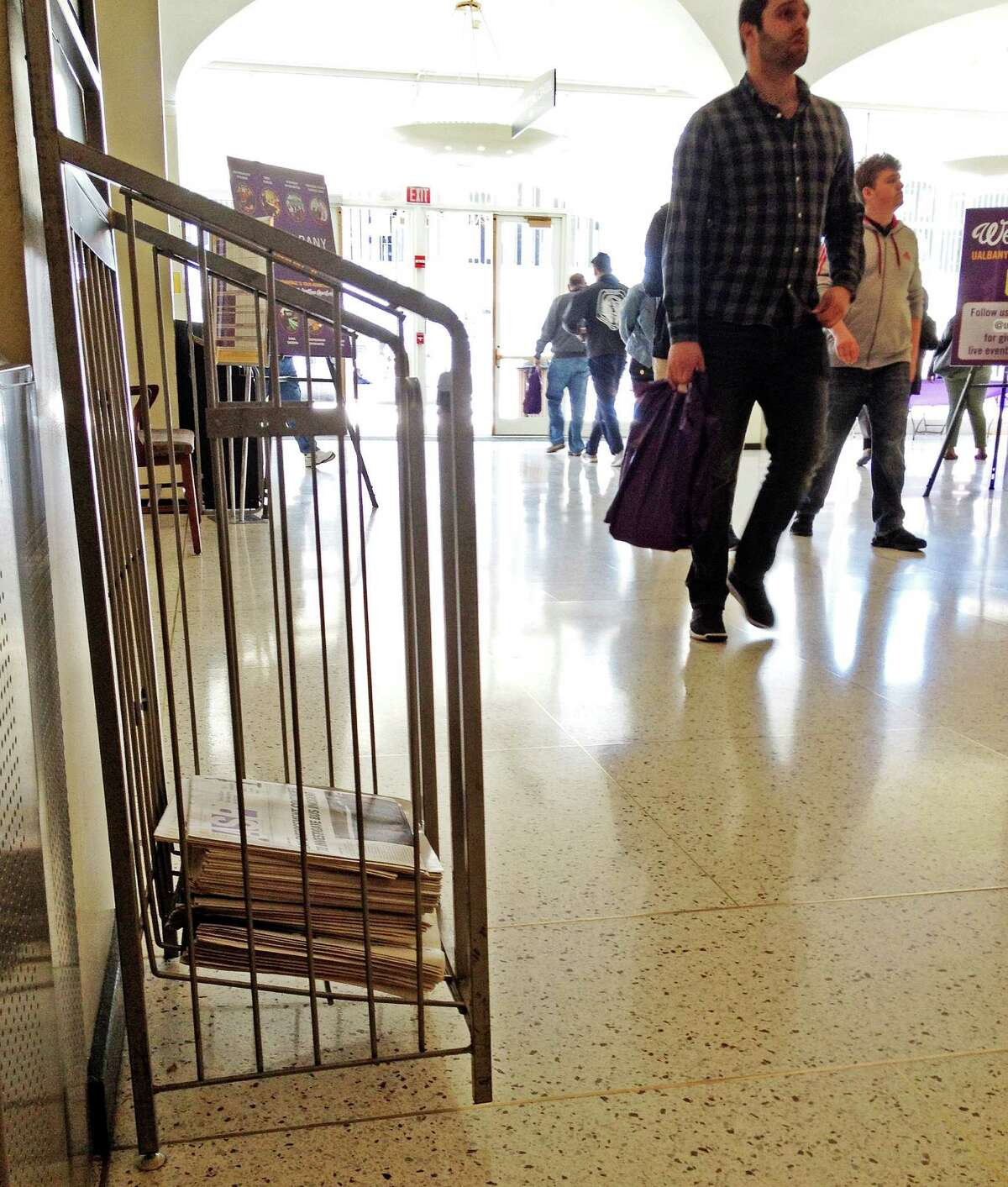 Students and families attending UAlbany's two-day Open House weekend event on Saturday, April 16, didn't see the Albany Student Press' report about a 200 percent increase in sexual assaults, published Tuesday, April 5. The newspapers had been removed from several metal racks such as this one in the Lecture Center Concourse ? where faculty had set up tables to interface with incoming students. Times Union photo.