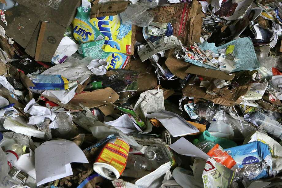 A pile of paper and plastic to be sorted at Texas Disposal Systems' $17 million materials recycling facility on the site of their landfill in Creedmoor, just south of Austin. Photo: Bob Owen /San Antonio Express-News / San Antonio Express-News