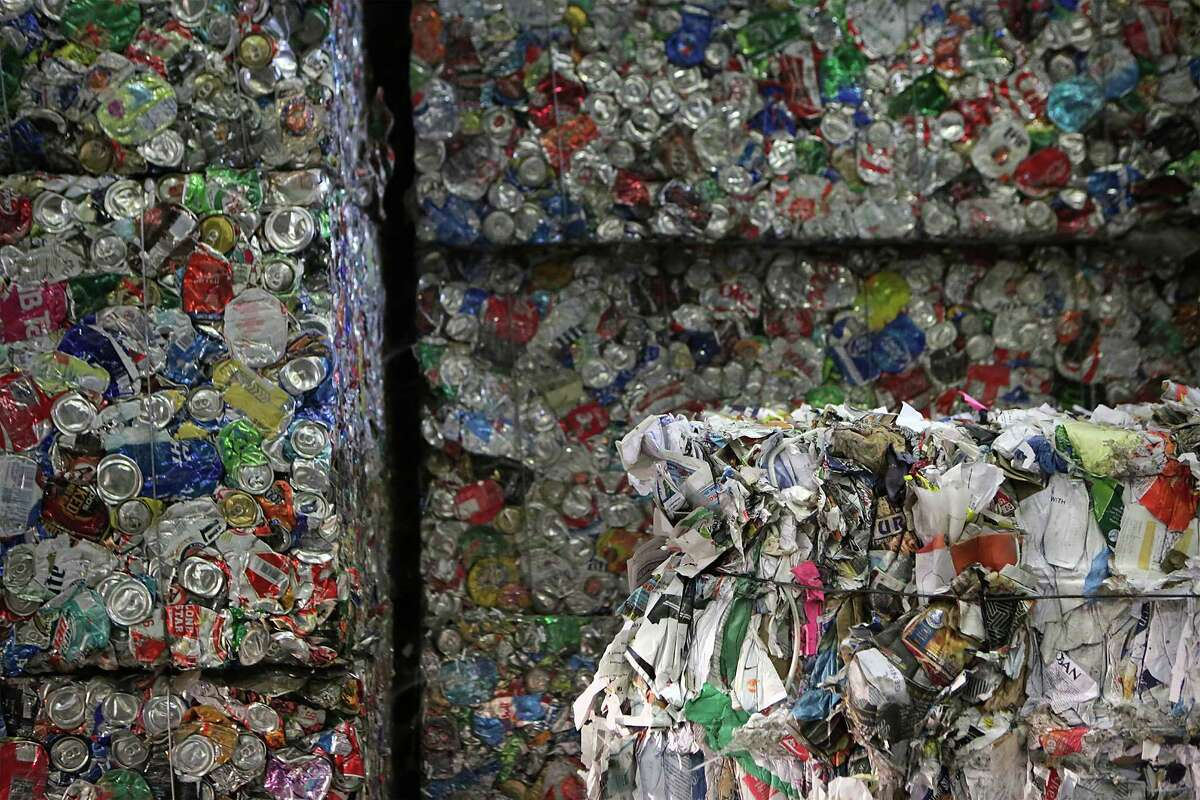 A bale of aluminum cans, left, and a bale of paper products at Texas Disposal Systems materials recovery facility, or MRF, on the site of the company's landfill in Creedmoor. Volumes of paper, a high-value recycling commodity, have decreased dramatically over the past 15 years.
