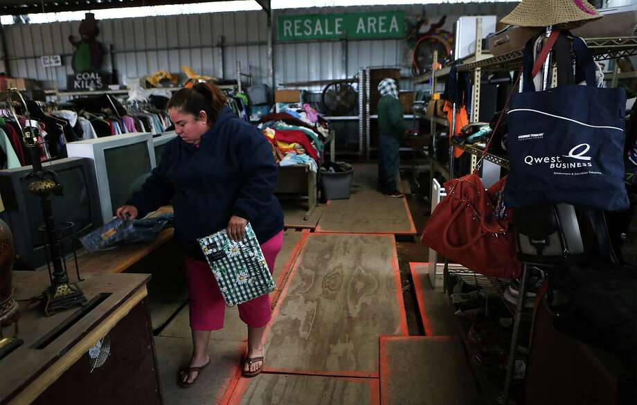 Shoppers look through items in the resale area at Texas Disposal Systems' landfill in Creedmoor just south of Austin. The facility takes in a lot of barely used exercise equipment. Photo: Bob Owen /San Antonio Express-News / San Antonio Express-News