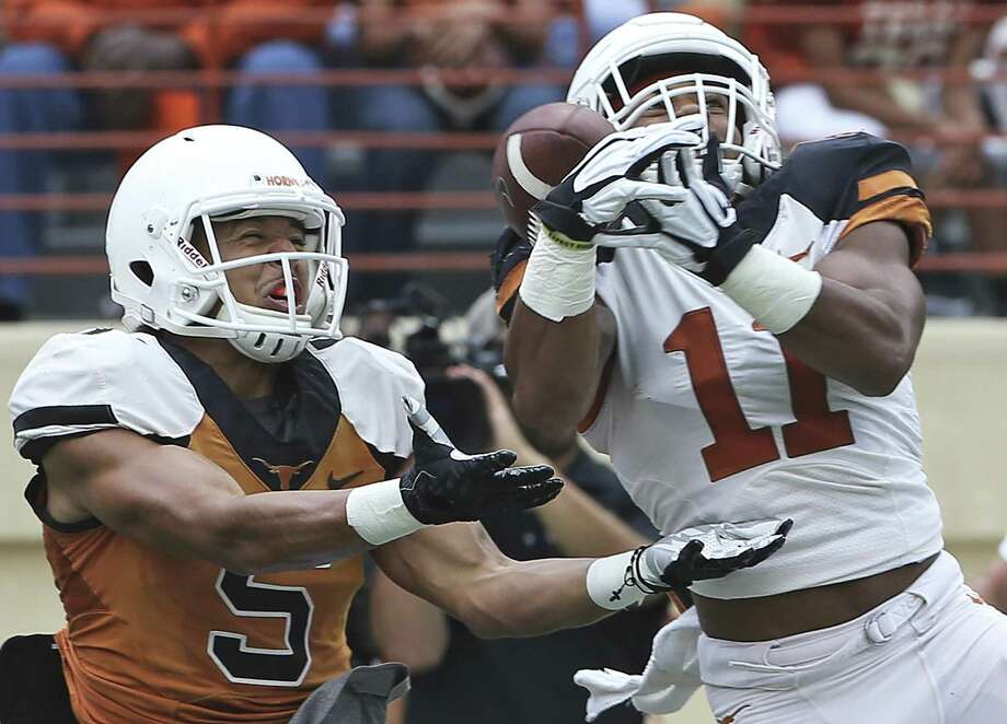 Defender P.J. Locke (11) breaks up a long pass intended for Lorenzo Joe during UT's Orange-White spring game at Royal-Memorial Stadium in Austin on April 16, 2016. Photo: Tom Reel /San Antonio Express-News / 2016 SAN ANTONIO EXPRESS-NEWS