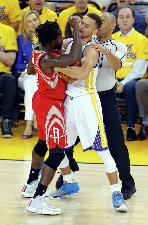 Golden State Warriors' Stephen Curry and Houston Rockets' Patrick Beverley tussle in 1st quarter in Game 1 of 1st round of NBA Playoffs at Oracle Arena in Oakland, Calif., on Saturday, April 16, 2016. Photo: Scott Strazzante, The Chronicle / ONLINE_YES