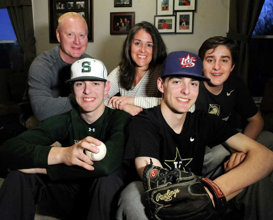 Twin brothers Ben Anderson, 17, front left, and Ian Anderson, 17, front right, who both pitch for Shenendehowa High's baseball team, on Thursday, April 14, 2016, at their home in Clifton Park, N.Y. Joining them is their parents, Bob and Karen Anderson, and younger brother Isaac Anderson, 13. (Cindy Schultz / Times Union) Photo: Cindy Schultz / Albany Times Union