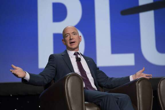 Amazon.com CEO Jeff Bezos told audiences at a symposium last week that reusable rockets - an innovation SpaceX and other private space firms are racing to perfect - would open the door to a commercial boom comparable to those created by the Internet and the national highway system.