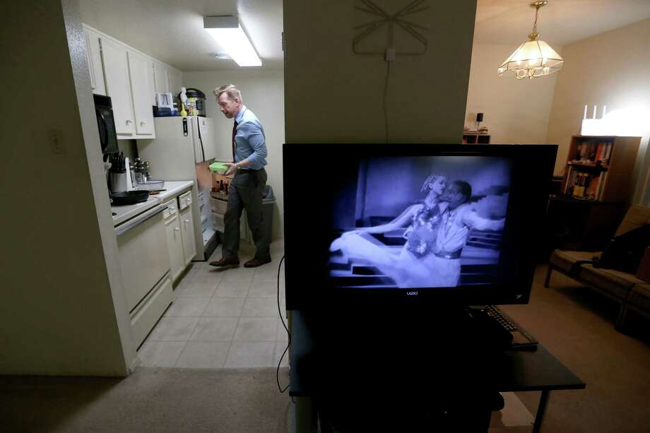 Paul Cummings in his one bedroom apartment Wednesday, April 13, 2016, in Houston, Texas. After 20 years of renting he's considering buying his first house but is unsure how to navigate the housing market. ( Gary Coronado / Houston Chronicle ) Photo: Gary Coronado, Staff / © 2015 Houston Chronicle