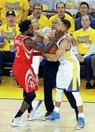 Rockets point guard Pat Beverley and Warriors star Stephen Curry briefly tussle during the first quarter Saturday.