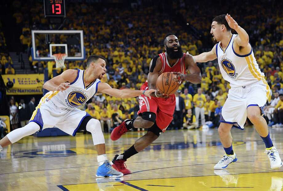One Game 1 surprise as James Harden attempted to split the Warriors' defense of Stephen Curry, left, and Klay Thompson was that the Rockets' star wasn't going to the free-throw line Saturday for the first time in 148 games. Photo: Thearon W. Henderson, Stringer / 2016 Getty Images