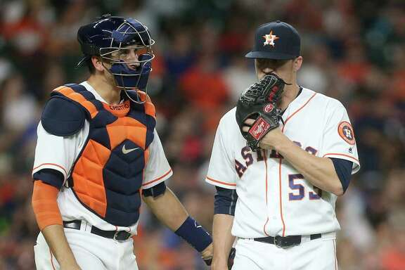 Houston Astros catcher Jason Castro (15) talks to Houston Astros relief pitcher Ken Giles (53) after a walk. Photos of second game in a three-game series between Houston Astros and Detroit Tigers on Saturday, April 16, 2016, in Houston. Astros lead the series 1-0.