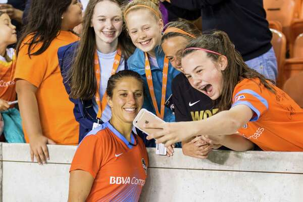 Dash midfielder Carli Lloyd (10) poses with fans after defeating the Red Stars 3-1 in the season opener of the National Women's Soccer League at BBVA Compass Stadium on Saturday, April 16, 2016, in Houston,TX.