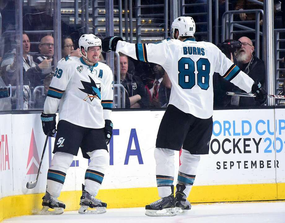 San Jose's Logan Couture, left, and Brent Burns celebrate Couture's power play goal in a first-round playoff game against the Kings. Photo: Harry How, Getty Images