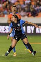 Dash midfielder Carli Lloyd (10) and Red Stars midfielder Danielle Colaprico (24) fight for position in front of the Red Stars goal in the first half of a National Women's Soccer League game at BBVA Compass Stadium on Saturday, April 16, 2016, in Houston,TX. ( Joe Buvid / For the Chronicle )