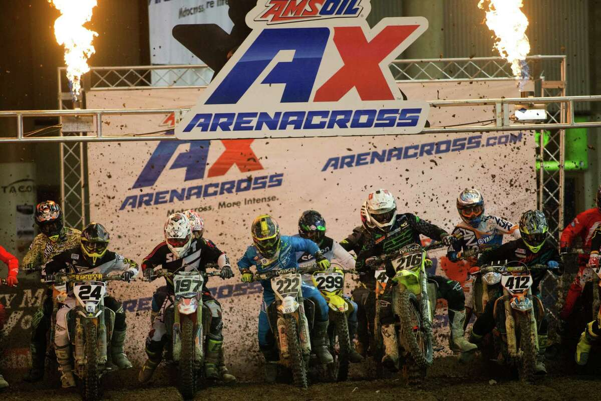 Arenacross class racers take off in their final heat of the night at AMSOIL Arenacross at the Tacoma Dome on Saturday, April 16, 2016.