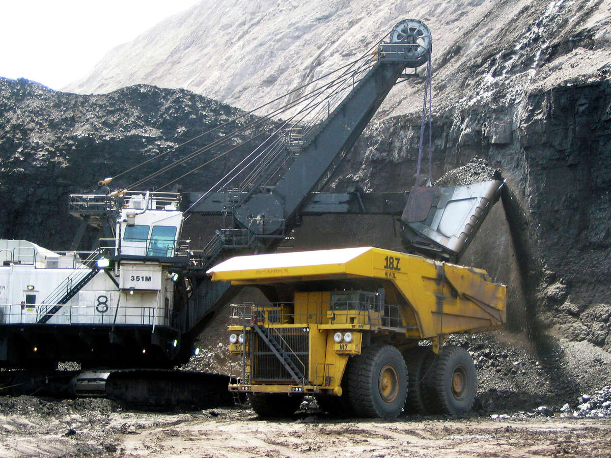 FILE - In this April 30, 2007, file photo, a shovel prepares to dump a load of coal into a 320-ton truck at the Arch Coal Inc.-owned Black Thunder mine in Wright, Wyo. Arch Coal filed for Chapter 11 bankruptcy protection in January 2016. The bankruptcy filing of coal mine operator Peabody Energy Wednesday, April 13, 2016, raises yet more questions about the ability of financially troubled coal companies to cover the potential cost of filling in mines that close.