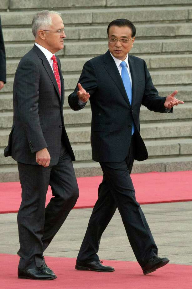 "Australian Prime Minister Malcolm Turnbull, left, pictured on a visit to Beijing.  Turnbull called for a plebiscite on same-sex marriage that drew 12.7 million votes.  Marriage equality won in a landslide.  ""The Australian people have spoken and they have voted overwhelmingly 'yes' for commitment, 'yes' for marriage equality, 'yes' for fairness, 'yes' for love."" Photo: Ng Han Guan, AP / Other"