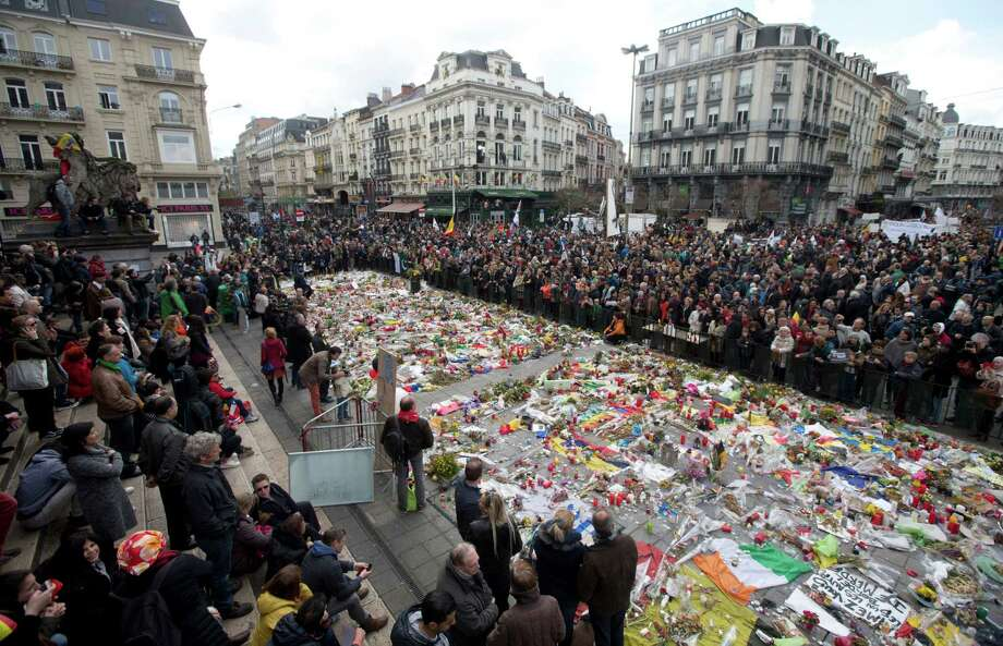 Marchers gather a memorial to victims of the Brussels attacks during a march against hate in Brussels on Sunday, April 17, 2016. Photo: Virginia Mayo, AP / Other