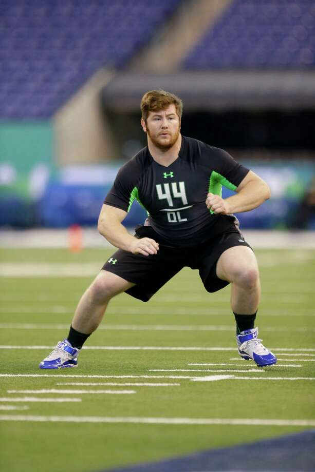 North Carolina State offensive lineman Joe Thuney runs a drill at the NFL football scouting combine in Indianapolis, Friday, Feb. 26, 2016. Photo: AP / AP