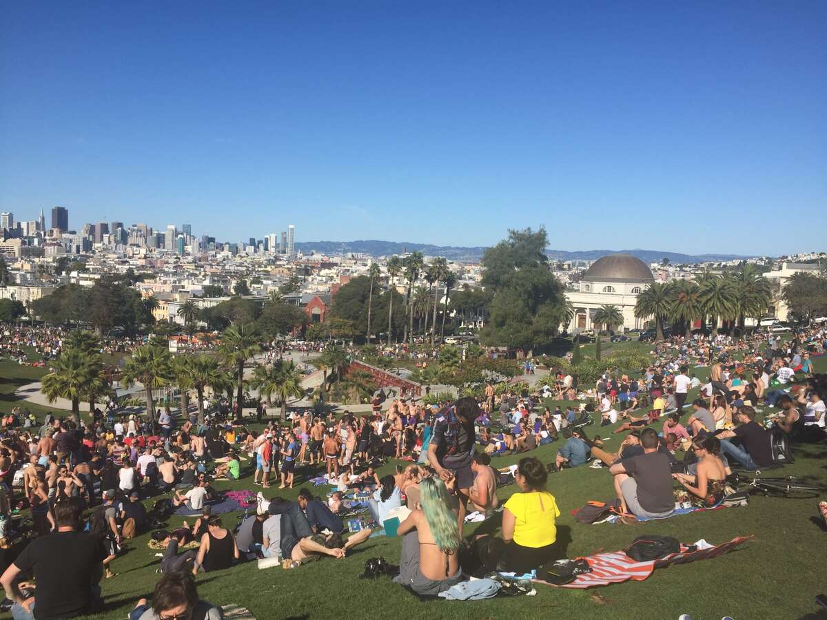Large crowds dot the hill at Dolores Park on Saturday as groups lounged in the weekend's warm temperatures.
